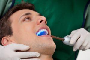 A man receiving dental bonding.