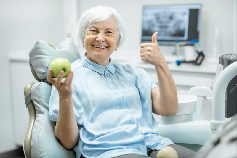 Woman smiling and giving a thumbs up