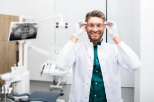 a specialist for dental implants in Pittsburgh putting on safety glasses