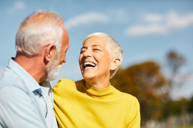older couple smiling and laughing together